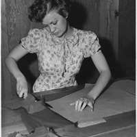 FDR library minnesota woman learning to sew.gif